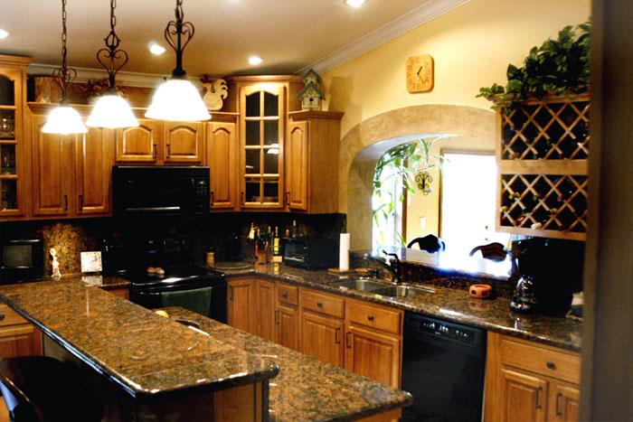 Kitchen image kitchen bathroom design center for Black and oak kitchen cabinets